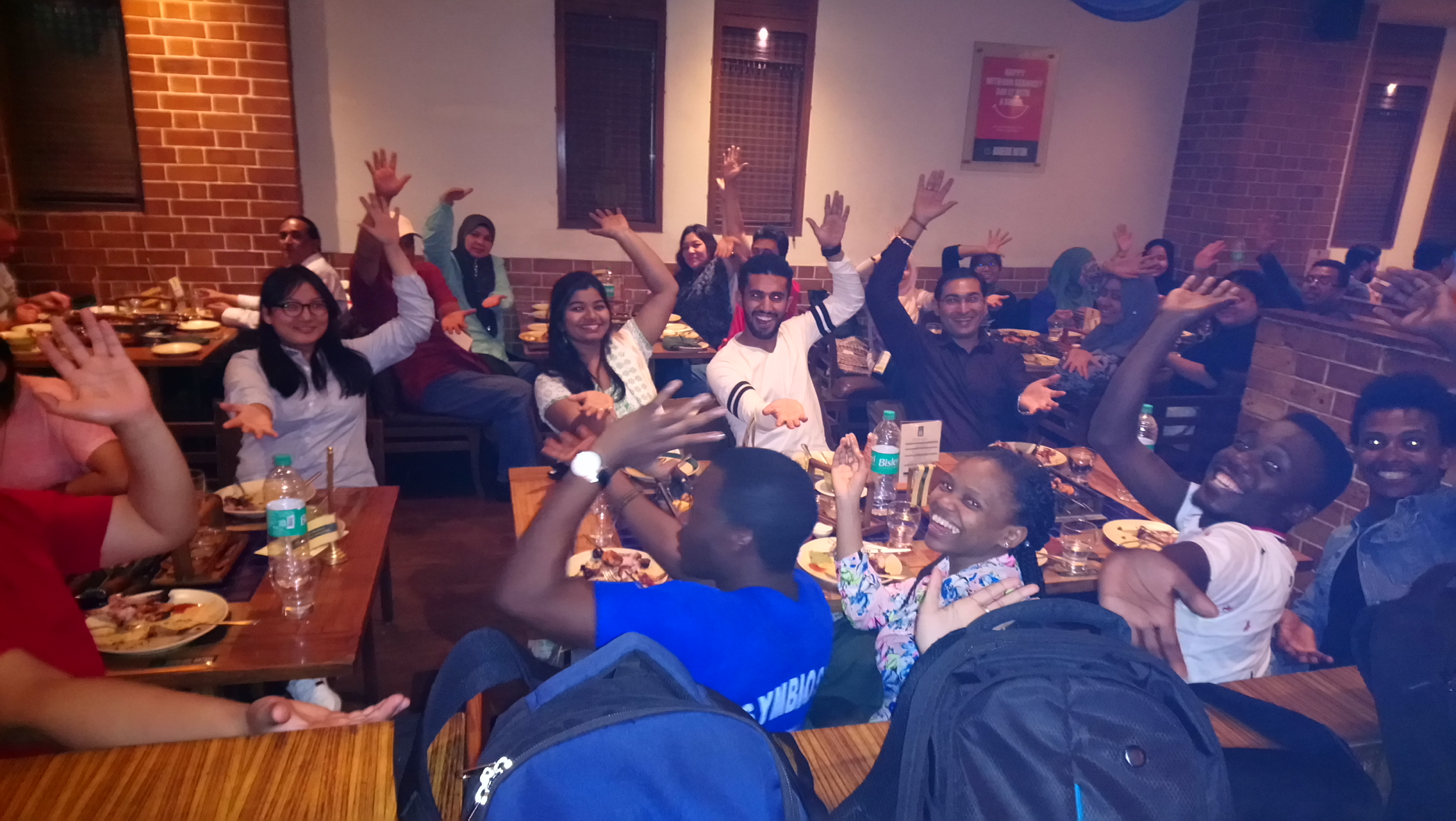 1st Innompic Games networking dinner hands up Innompics gesture